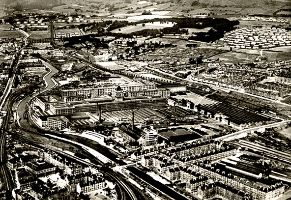 Clydebank Circa 1941. Looking  West, Singers  Clock  in centre of image. The category A target, the Dalnottar oil tanks  top left.